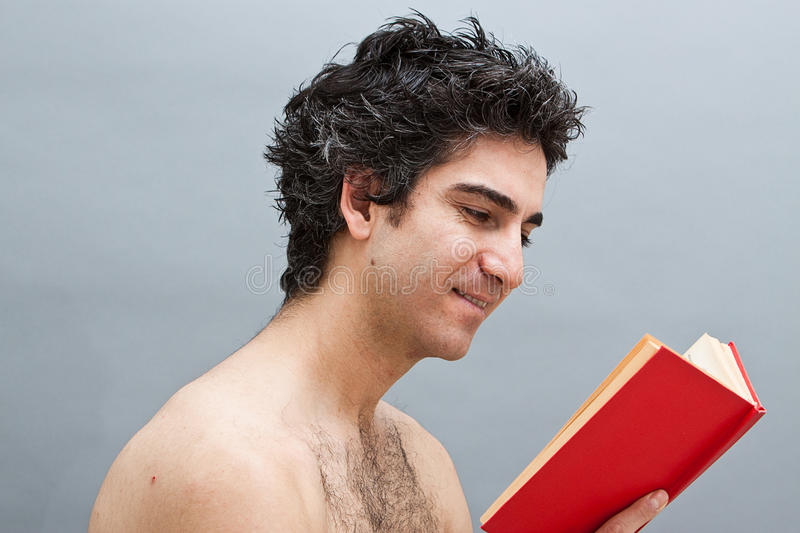 Reading a fun book stock photos