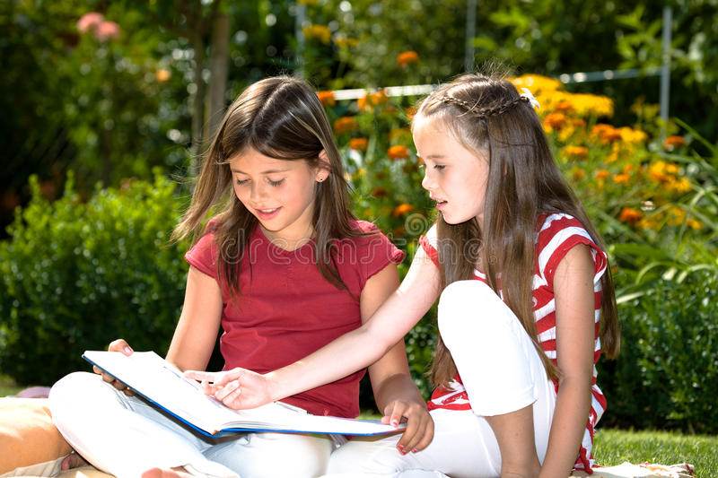 Reading in garden royalty free stock image
