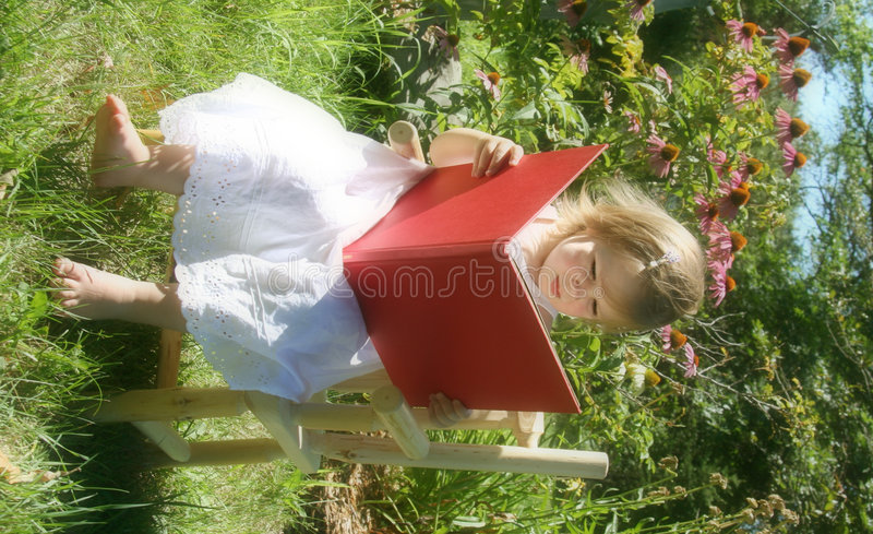 Reading in the garden royalty free stock images