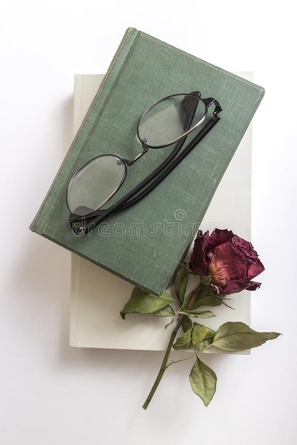 Reading glasses on book with flower royalty free stock images