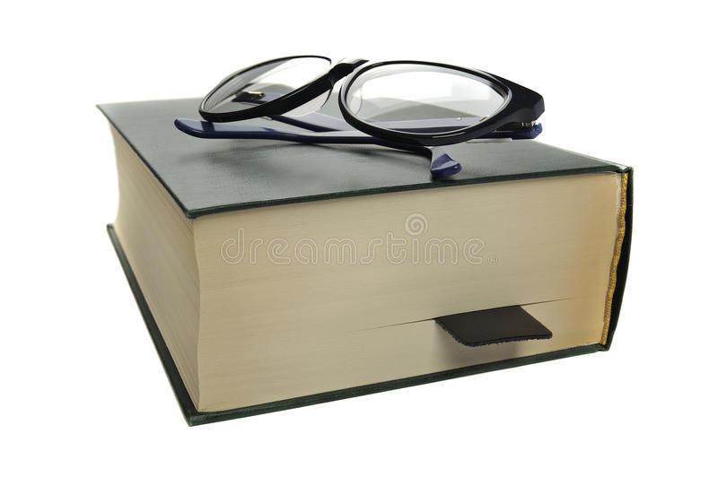Reading glasses on an closed book stock photo