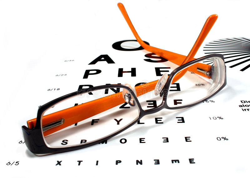 Reading glasses on eye chart. A pair of orange and black spectacles on an eye chart
