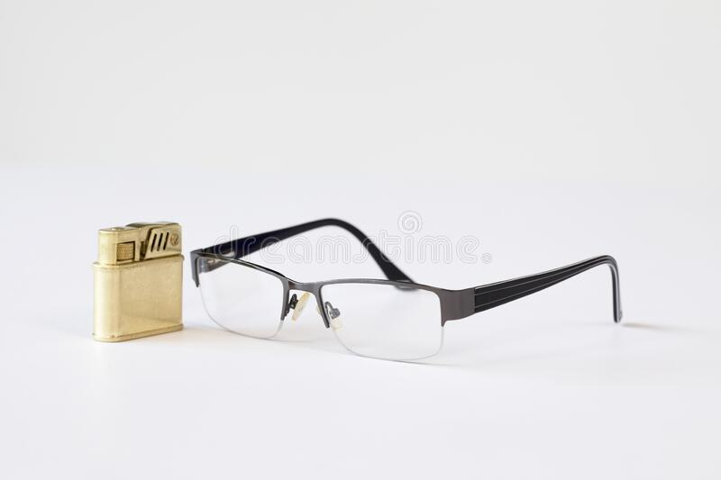 Reading glasses. And a lighter stock images