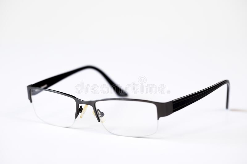 Reading glasses. On a white background stock image
