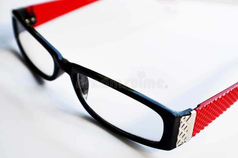 Reading glasses on white background royalty free stock photography