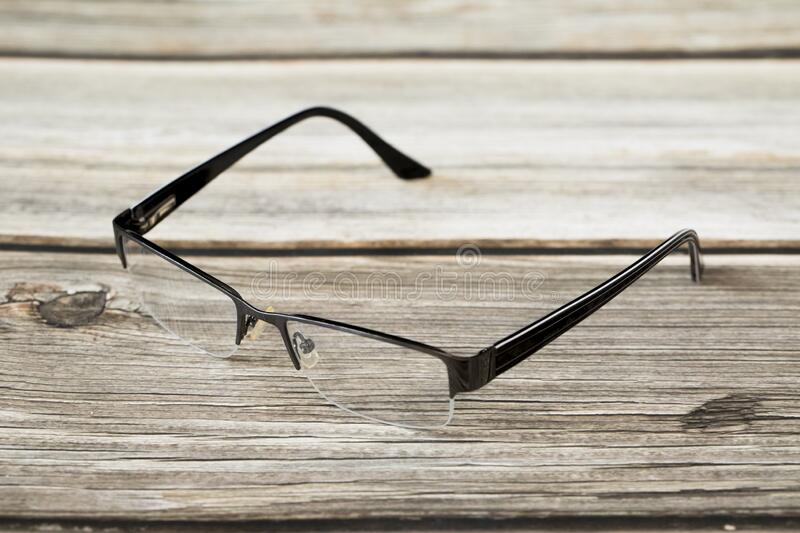 Reading glasses. And a wood background royalty free stock photos