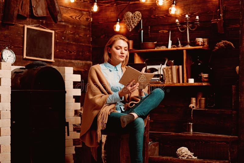 Reading for her own enjoyment. Pretty woman read a book. Woman student enjoy reading literacy. Student get knowledge. From book. Knowledge and reading royalty free stock images