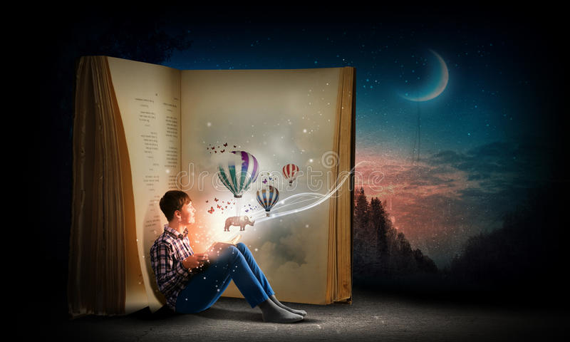 Reading and imagination royalty free stock photography