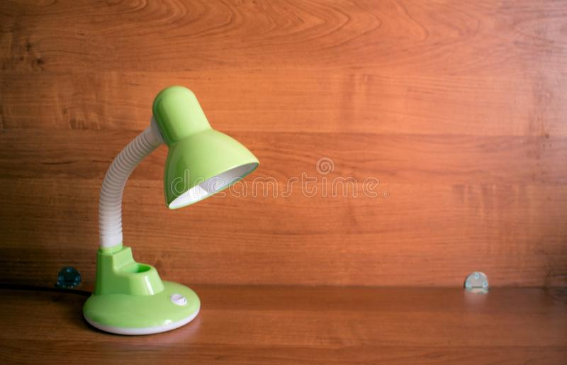 Reading-lamp, table lamp. Green colour stock images