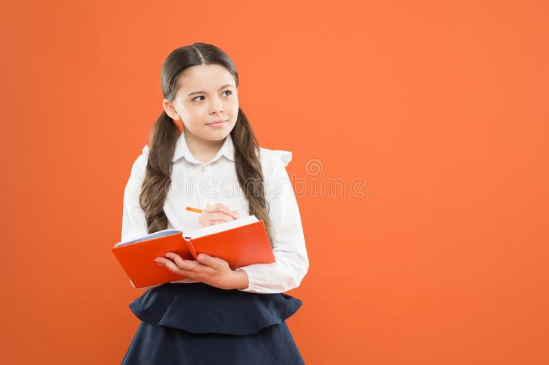 Reading lesson. Happy child enjoy study and reading book. back to school. get information form book. small girl at. School lesson. schoolgirl writing notes on royalty free stock photography