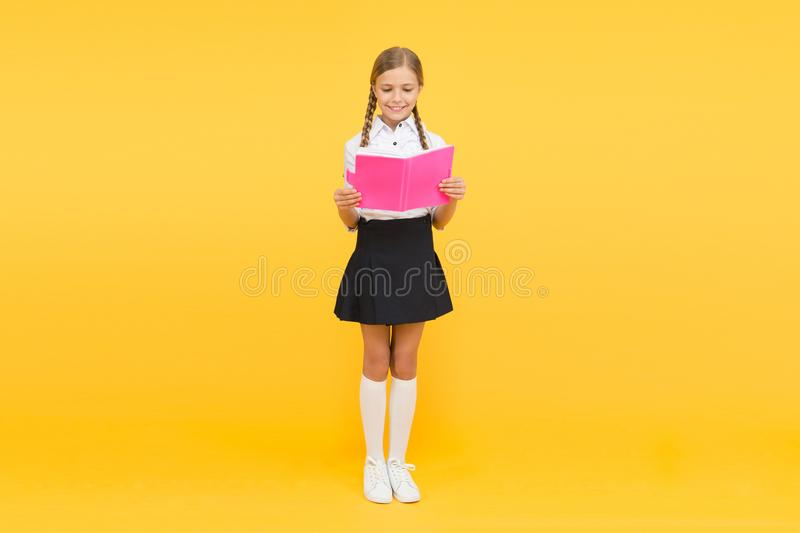 Reading literacy. happy girl study hard with notebook. literature lesson. childrens literature. back to school. Pupil at. Book store or library. small girl stock image