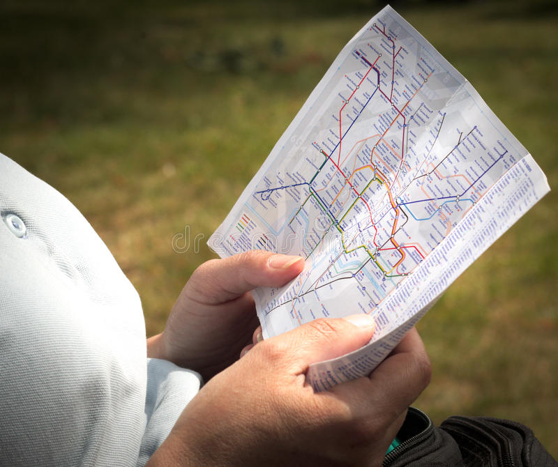 Reading the London tube map stock photography