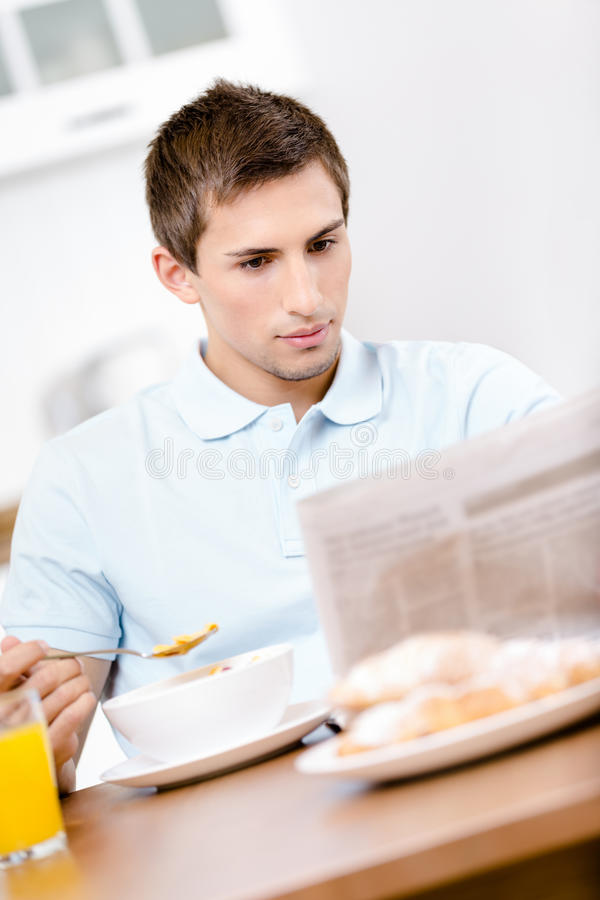 Download Reading Man Eats Tasty Breakfast In Kitchen Stock Image - Image: 30457927
