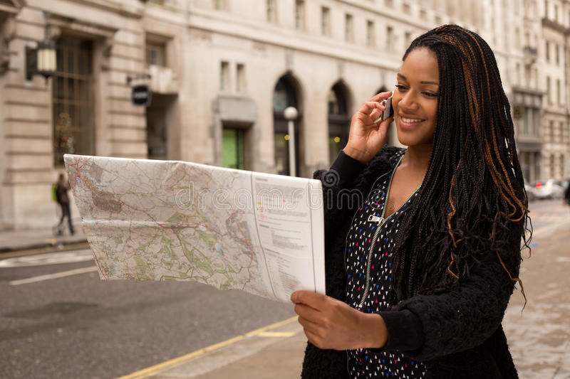 Reading map on the phone royalty free stock photos