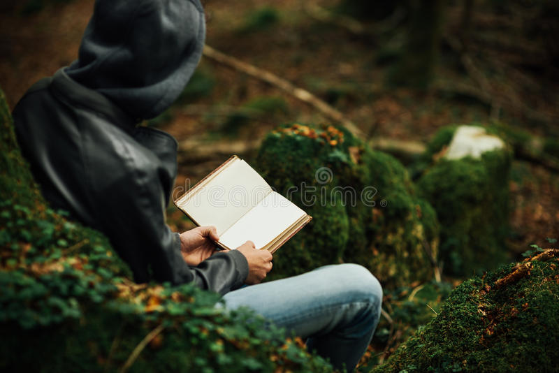 Reading in nature royalty free stock photography