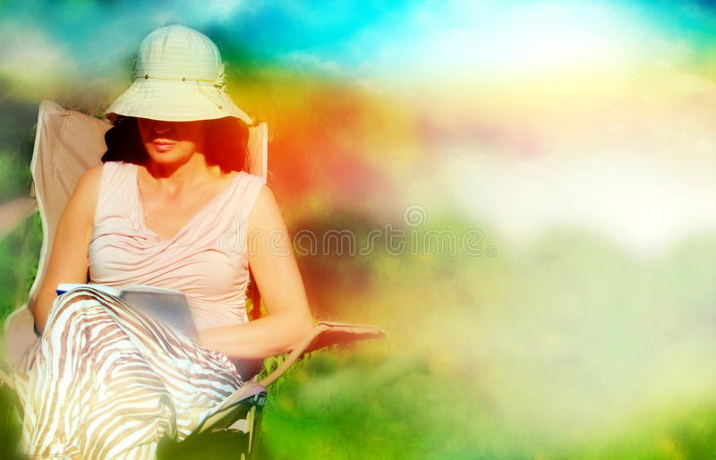 Reading in nature is my habit stock photography