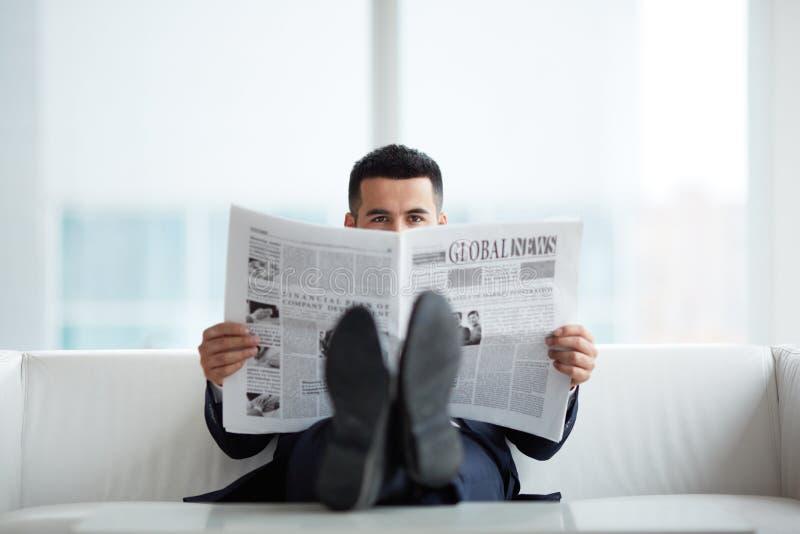 Reading news stock photography