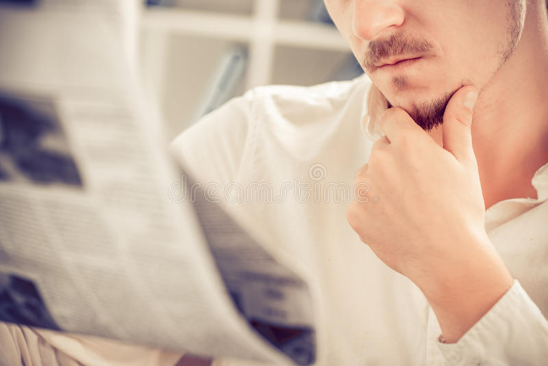 Reading newspaper stock image