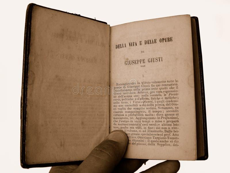 Reading old book. Reading nineteen century original books Opere di Giuseppe Giusti Italian poet (1809 - 1850) - antiqued royalty free stock photo