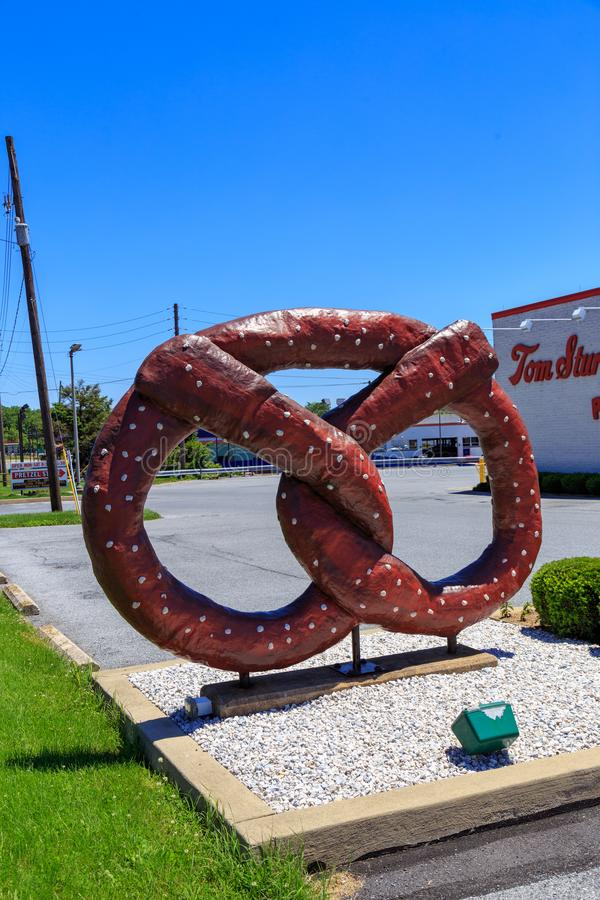 The Sturgis Pretzel Sign. Reading, PA, USA - June 14, 2018: A large pretzel sign at Tom Sturgis Pretzels, a commercial bakery near Shillington, Berks County, PA royalty free stock photography