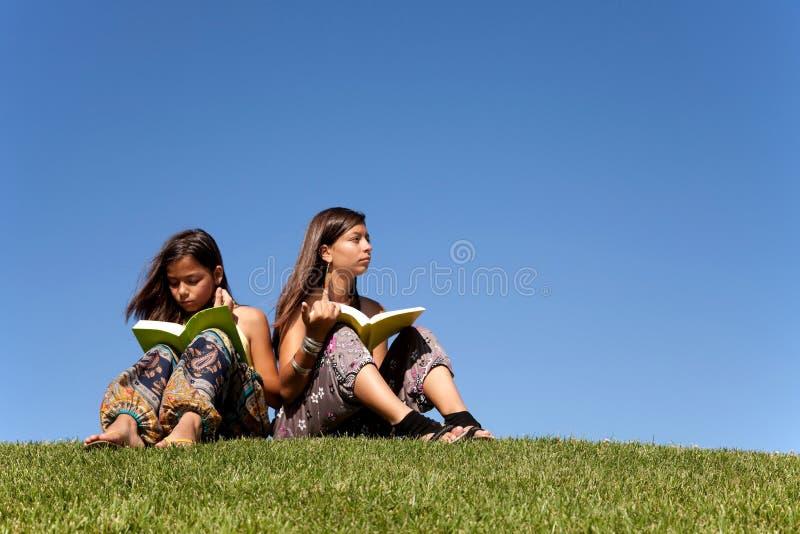 Reading at the park royalty free stock photos