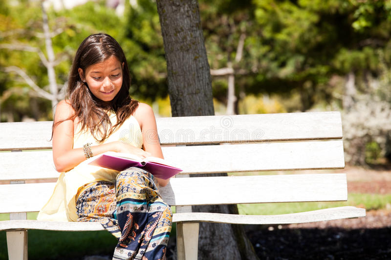 Reading at the park stock photography