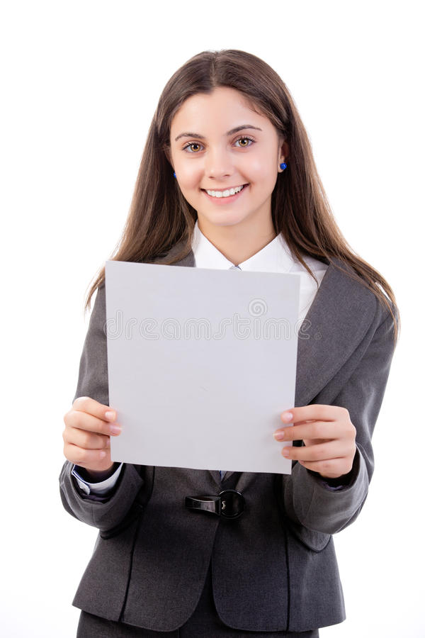 Reading a report. Young business woman reading her report. Isolated on white stock photography