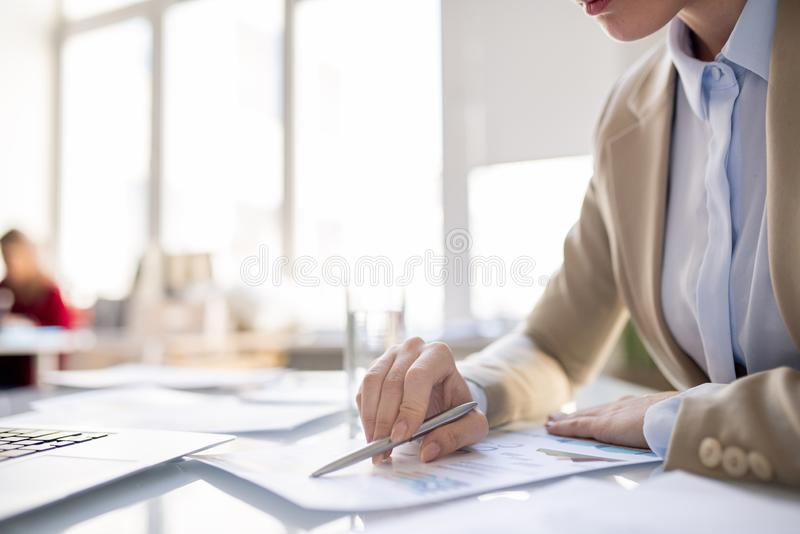 Reading report information in office stock photo