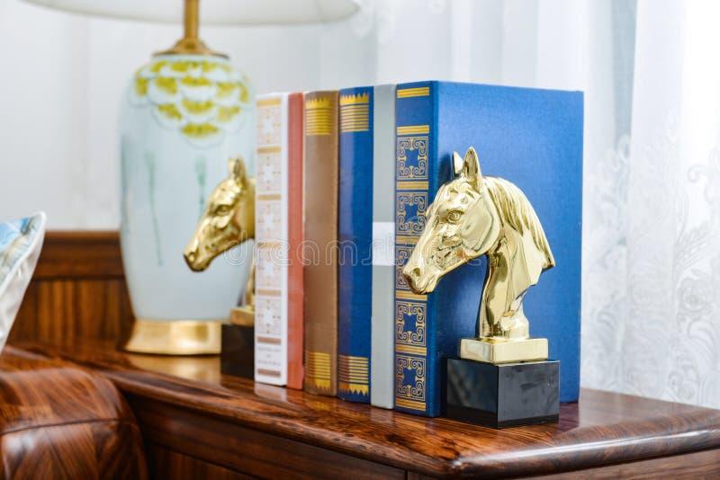 Reading room golden horse head bookshelf. Home interior decor, Golden horse head bookshelf in reading room stock photos