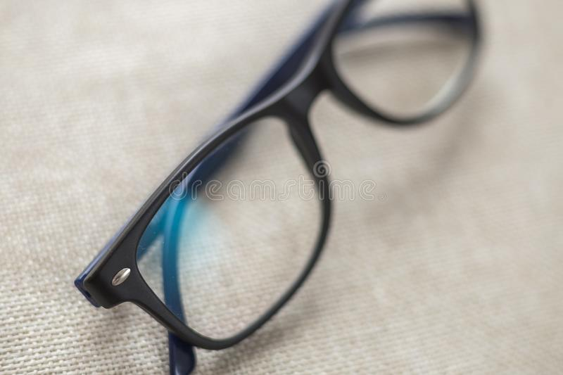 Reading spectacles, fashionable eyeglasses isolated on blurred white copy space background stock photos