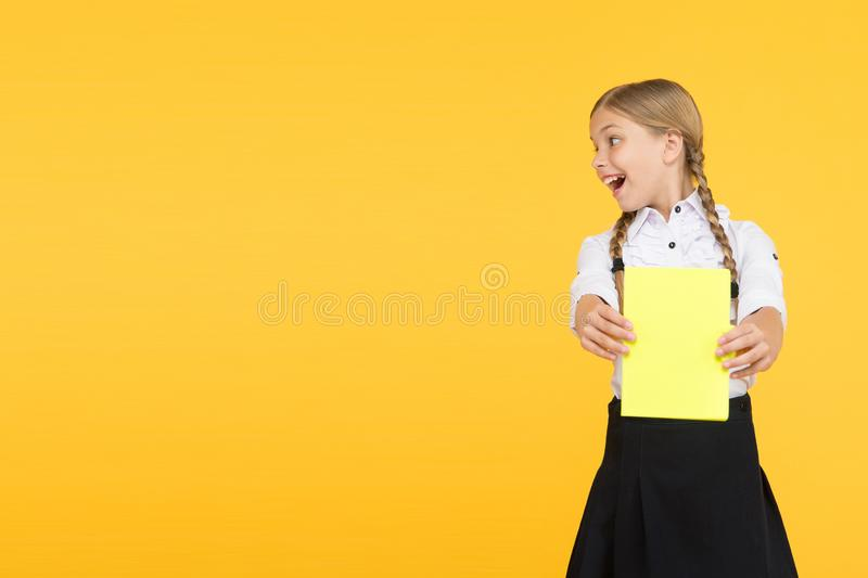Reading story. childrens literature. dictionary notebook. Get information. kid learning grammar. back to school. Cheerful girl with workbook. Education. small stock image