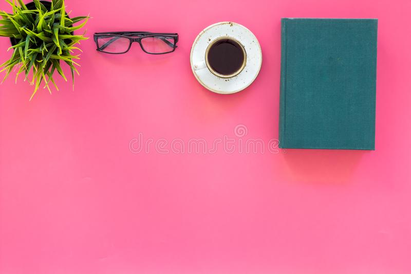 Reading for study and work. Self-education concept. business literature. Books with empty cover near glasses, coffe. Plant on pink desk top view stock photos