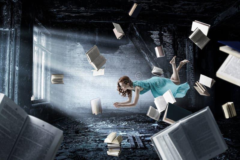 When reading takes you away. Mixed media stock image