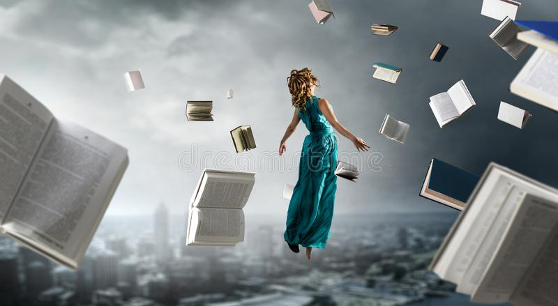 When reading takes your away. Mixed media stock photography