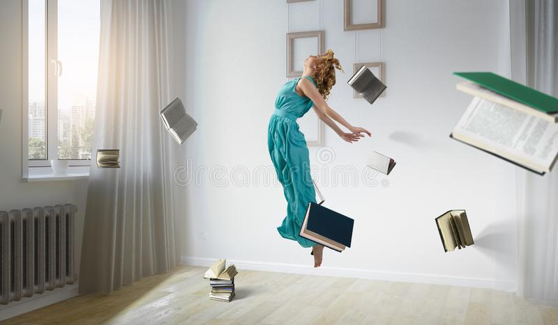When reading takes your away. Mixed media royalty free stock image