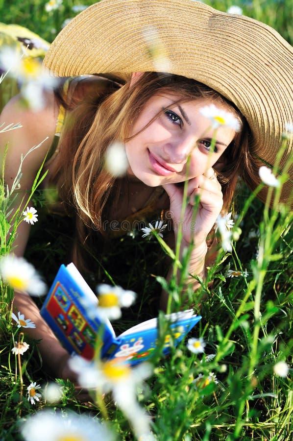 Reading teen girl stock photography