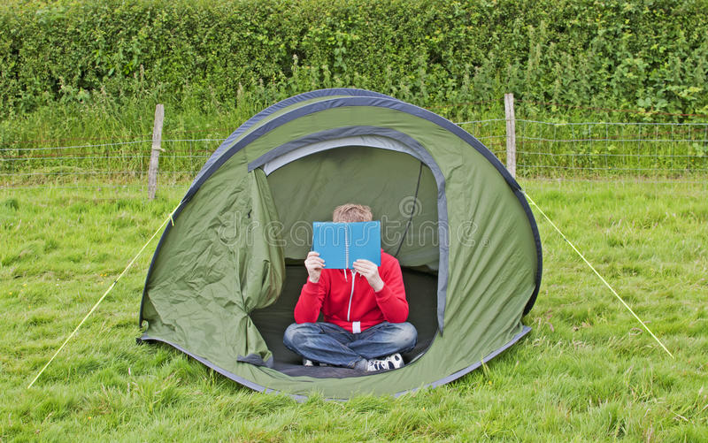 Reading in the Tent royalty free stock photography
