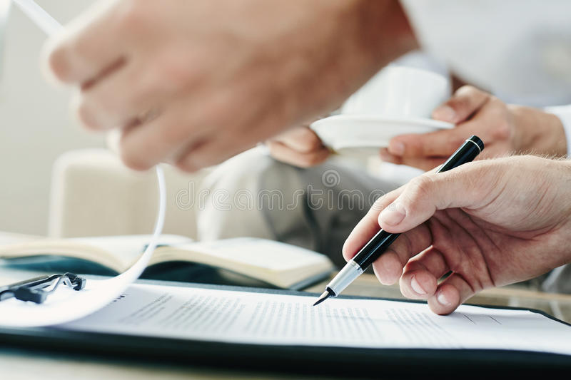 Reading terms of contract stock image
