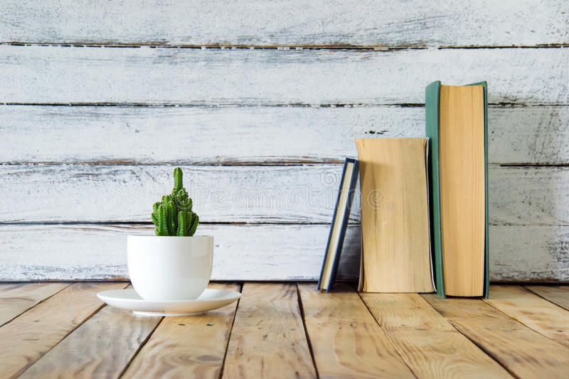 Reading time. Reading environment with small table top plant stock image