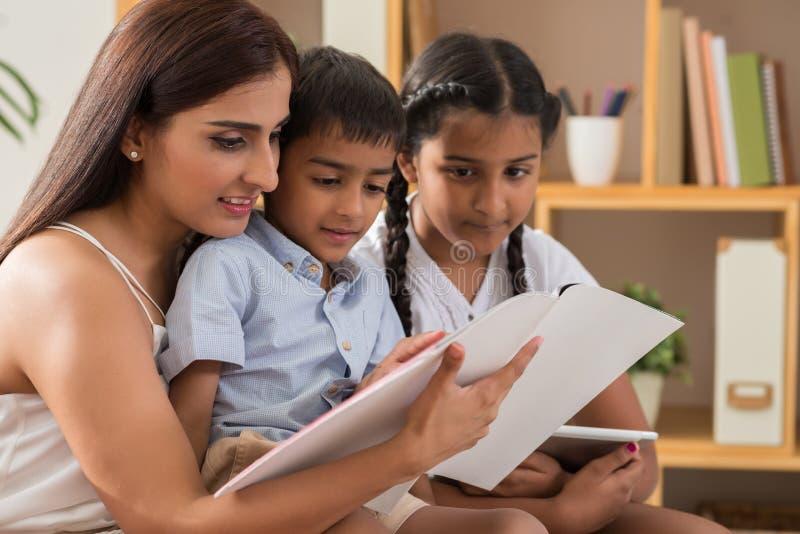 Reading to children stock photos