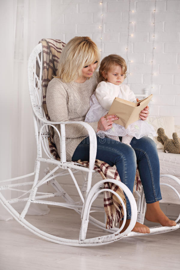 Reading to her daughter stock image
