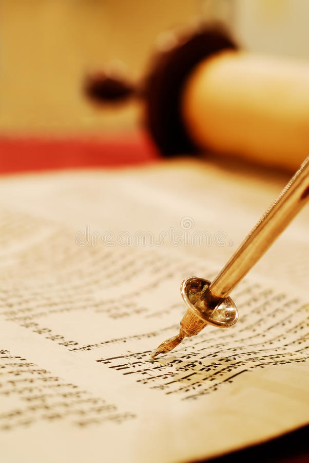 Reading the Torah Scroll. Torah scroll with a pointer, called a yad. Scroll is opened to Exodus 20, the 10 commandments stock photos