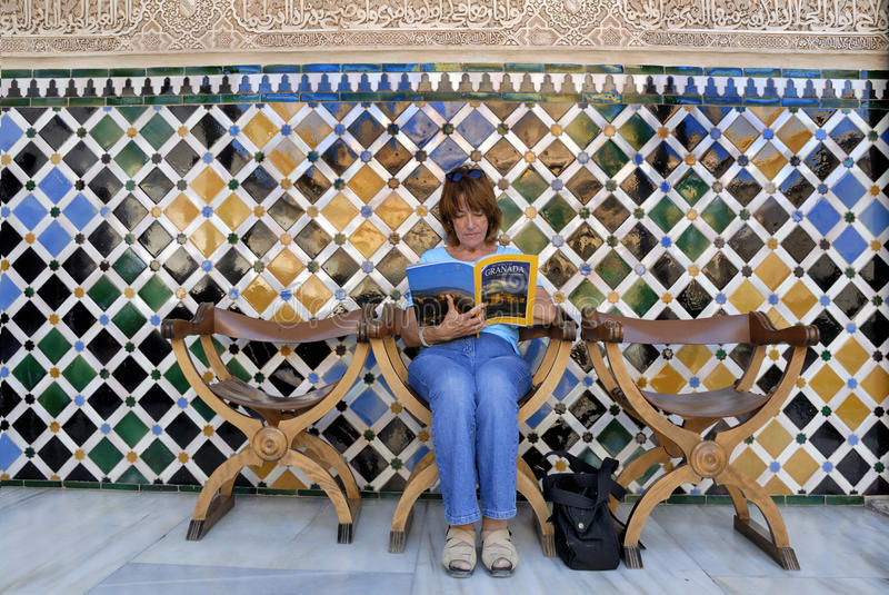 Download Reading a tourist guide editorial stock photo. Image of moorish - 20862558