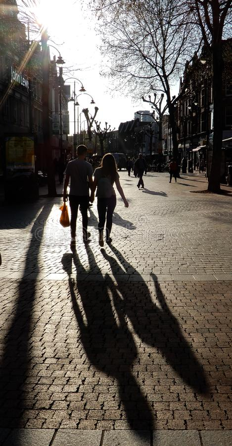 Sunset shoppers silhouette stock images