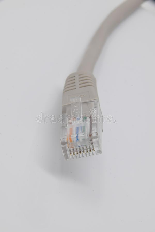 RJ45 CAT5 cable. Reading, United Kingdom - February 03 2018: The RJ45 connector of a CAT5 ethernet cable royalty free stock photography