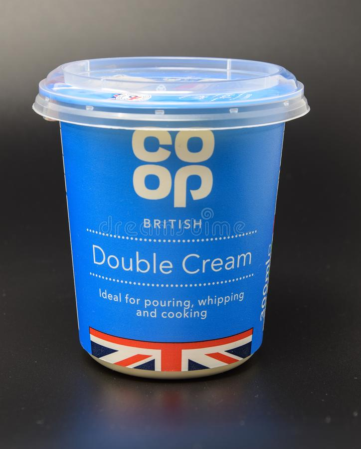 Co-op double cream. Reading, United Kingdom - March 26 2018: Pack shot of a tub of Co-op branded double cream royalty free stock photos