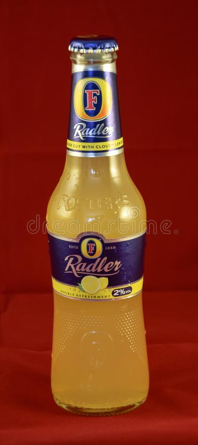 Fosters Radler bottle. Reading, United Kingdom - May 02 2015: A bottle of Fosters Radler, a lager shandy made with cloudy lemonade by Australian Brewery Fosters stock photo