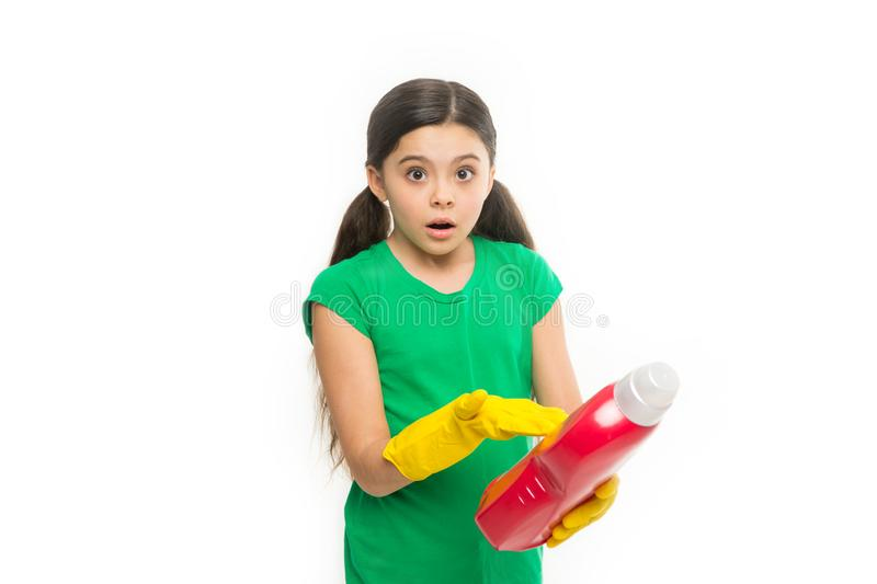 Reading washing instruction for using household cleaning product. Small child holding laundry detergent. Cute cleaner royalty free stock image