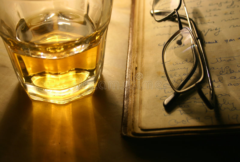 Reading with Whiskey stock images