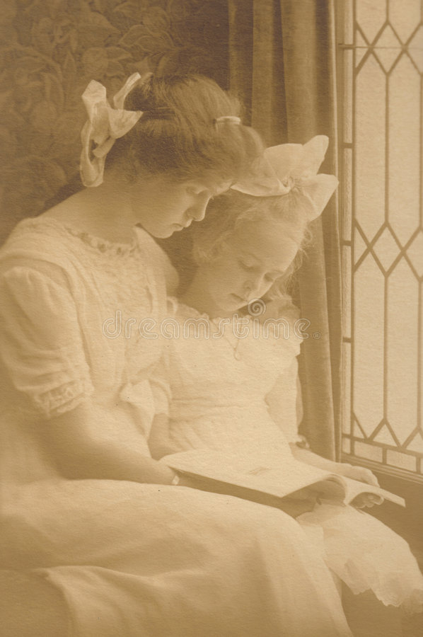 Reading by Window - Vintage Victorian stock photography